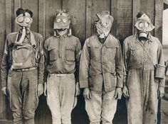 WORLD WAR I: GAS WARFARE. American soldiers demonstrating the different types of gas masks worn by (left to right) U.S., British, French, and German troops.