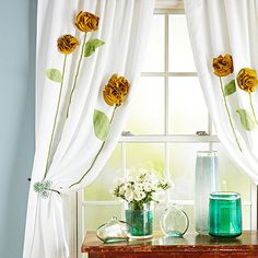 Spruce up plain white curtains with a flower embellishment.