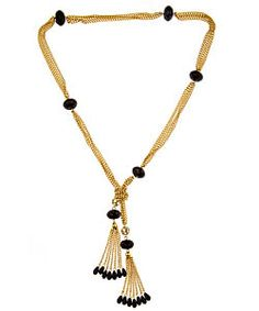 Loren Hope Flapper Tassel Lariat Necklace  Inspired by 1920's glamour, this Loren Hope Flapper tassel lariat necklace captures a vintage look. The necklace is in a lariat style and features a pendant made of two tassels. Gold and jet black stones combine in this piece to create a luxurious look.