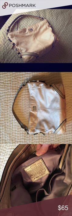COACH champagne leather shoulder bag Soft leather, champagne shimmer color, sort of silverish/goldish hues w silver accents. Lavender interior w/2 interior pockets and a side interior zipper compartment Coach Bags Shoulder Bags