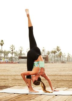Woah. I only can get my left leg half high. How can she make that look so easy? :(