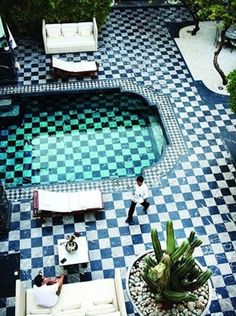 Love the black and white checkered marble floors and white, composed granite in the area where the table is set up.