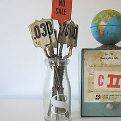 Cash Register Price Flags: These antique double-sided cash register price flags have their original metal spring and would pop-up behind the glass on top of the register so that both the shopkeeper and customer could see the amount being rung up