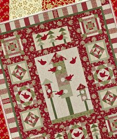 "Home For The Holidays fabric by Faye Burgos for Marcus Fabrics. The quilt is House Warming Party"", a BOM by Vicki Belllino."