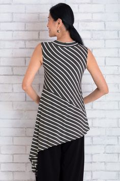 Coastal Striped Tunic by Lisa Bayne . This dramatic, easy-to-wear tunic makes a statement with playfully angled stripes and an asymmetrical hemline that plunges to a long side point.