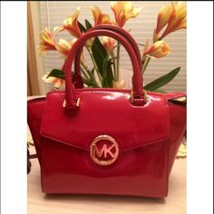 MK PURSE BRAND NEW• Never worn• Strap still wrapped in original paper//bag filled with all original paper• MD SATCHEL• Beautiful red shiny leather• MSRP $368• Offers are welcome//low balls are NOT. Measurements are as follows 9 1/2 in long at the bottom, 13in long at the top, 5 1/4in width, 8in height. Michael Kors Bags Satchels