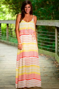 This maxi is absolutely gorgeous! The sheer material and the pink and yellow combo is divine! The thin sash around you waist will give that great fit! Wear this to run errands or a day out with the gals and look fab!