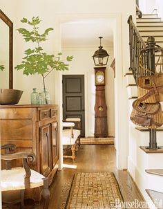 All the antique American hooked rugs in this house designed by Barbara Westbrook, including those in this entryway, are from Rubs by Robinson.   - HouseBeautiful.com