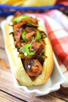 Caramelized Bourbon Glazed Onions & Bacon on this Bourbon Onion Bacon Dog is the perfect hotdog to serve for National Hotdog Day or National Hot Dog Month!