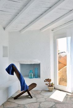 Simple interior design, white walls. use of deep sky blue in the interior.