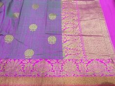 Voilet shaded banaras Dupion silk saree with bright pink zari border and all over butties with antiq gold zari