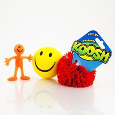 Koosh ball, small bendy smile person and a smile stress ball