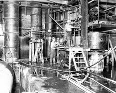"Distillery, 1931, discovered by Prohibition agents on the city's West Side in 1931, produced 5,000 gallons of liquor a day. (From photogallery ""Chicago's defining moments: 1840-1963"" trib.in/mVZ3Qp)"