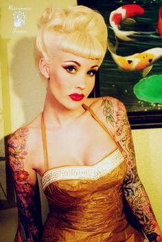not just this girl, pretty much any girl who  can pull off fully inked arms. It gives me hope. <3