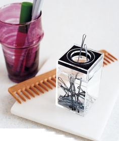 Paper Clip Dispenser as Bobby Pin Holder - Corral bobby pins and hair clips in a paper clip holder. The magnetic ring makes them easy to dispense.