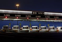 The Bay Bridge toll plaza sits empty shortly after its scheduled 8 p.m. closing. Workers now have until early Tuesday to make the new eastern span ready for that morning's commute. Photo: Brant Ward, The Chronicle