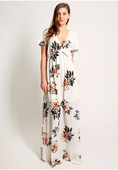 """White floral printed maxi dress with v-neckline, short sleeves and elasticated waist. Partially lined., , 100% Polyester, Imported, 34"""" bust, 61."""
