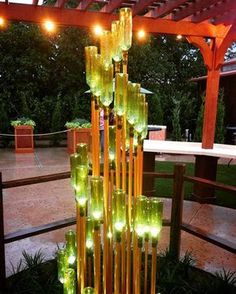 Spotted this gorgeous light fixture at Epcot. It's just green wine bottles + copper-painted PVC pipe, so great DIY potential!