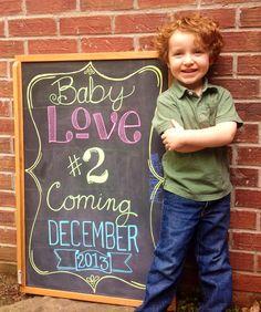 Pregnancy announcement on chalkboard!