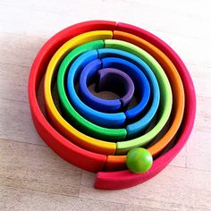 wooden rainbow as ball or marble track (inspiration only, not a direct link)