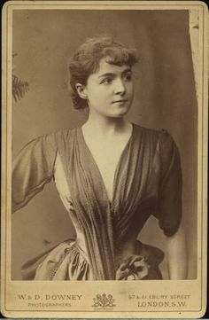 A Victorian beauty, 1880s. But look at that waist!  She is cinched in to within an inch of her life! How can she breathe???