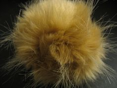 How to Make Your Own Tribble...  My dad bought me one from the Star Trek exhibit, but he needs babies. So, my friend is going to make some for me. :)