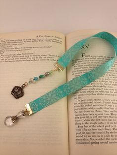 Mint green ribbon bookmark handmade with crown charm and crystals repurposed from vintage jewellery. $15.00, via Etsy.