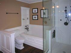 Complete bathroom remodel, new hardwood floors, custom glass shower enclosure, white and beige.