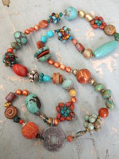 "Similar to my ""ugly"" necklace design that combines a ton of different beads on a long strand. Kim Otterbein Design - Coral necklace"
