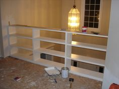 I've got a few places in my house where I've built in storage cabinets with plywood sides and shelves with 1x2 trim on the front. The only photo I've got handy is an in-process one of some bookcases, but hopefully it gives the basic idea. These are all painted our cream trim color. I need doors on a...