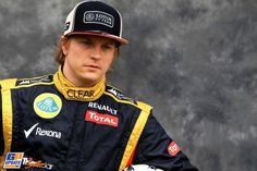He's back!!! Kimi Raikkonen looks gorgeous on black Lotus F1 Team ;)