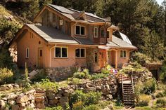 A Colorado couple delves into straw-bale building to create an artistic, nature-inspired dream home crafted from reclaimed building materials. ; This is one of the most beautiful homes I've seen, click for photos of the interior!