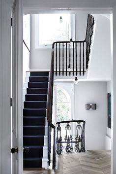 Referencing layout of staircase, french windows on the bottom landing, and wood floor