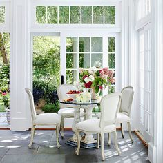 Sunroom Decorating and Design Ideas - Here, most of the sunroom is given to living space, but the small, classical-style table and chairs - Home Design, Interior Design, Design Ideas, Diy Design, Outdoor Rooms, Outdoor Furniture Sets, Rustic Furniture, Furniture Storage, Outdoor Dining