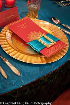 Indian Wedding Menu with blue satin ribbon and gold buckle