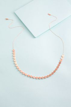 Long, rose gold plate necklace with a flashy flare.