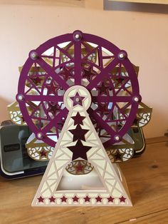 Made by Gina Duff - This is the carousel from the Cutting Craftorium Play USB. It is made from pearlescent cardstock in my daughter's wedding colour theme and was used to hold sweets at the reception.