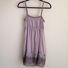 Dress / Tunic Cute lightweight 80% rayon 20%nylon dress or tunic with adjustable straps .  It is s bit sheer in the sunlight if worn as a dress. Could  be worn over jeans, legging too!! Washed once, never worn !!! Mine  Dresses