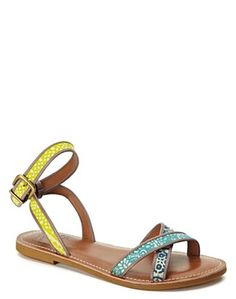 I think you could wear these with anything from a maxi skirt to shorts. Love the multicolored straps; $69.