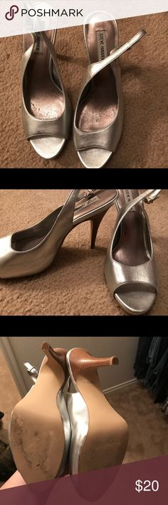 Steve Madden Silver Sling Heels women's size 10 I bought these shoes for my best friend's wedding and wore them once. The scuffs were manually placed there to avoid sliding around the wedding venue. Steve Madden Shoes Heels