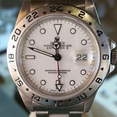 Rolex Explorer II Rolex Explorer II  Model: 16570 Year:1995-1997 Men's Features: Automatic movement with date/ sapphire crystal  Case: Stainless steel w/ 24hr GMT fixed bezel (40mm)  Dial: white w/ luminescent hour/ minute/ sweep seconds hands and indices, red GMT second time zone hand and magnified date display at 3 o'clock  Bracelet: stainless steel oyster Rolex Jewelry