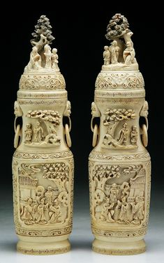 "Pair Chinese Antique Carved Ivory Vases With Covers: both of rounded form with two loose rings pending from shoulder, very detailed carved around the body with panels of figures resting in pavillion, each cover carved with figures conversating under pine tree, signed on bases, of Qing Dynasty  Dimensions: H: 11-3/4"" (each)"