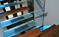 Lighted Think Glass Steps  Oh yes! Interspersed with chunky walnut steps!