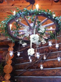 T Lazy 7 Wagon Wheel Decor- hanging candles Wagon Wheel Garden, Wagon Wheel Decor, Wagon Wheel Chandelier, Flower Chandelier, Rustic Chandelier, Chandeliers, Lighted Wedding Centerpieces, Garden Party Wedding, Summer Wedding