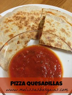 Pizza Quesadillas - a kid friendly lunch idea for summer! For future reference spread the sauce on the first tortilla and also use it as a dipping sauce.