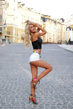 Leggy blonde on the cobblestones showing off her...   Great Legs and Stylish High Heels