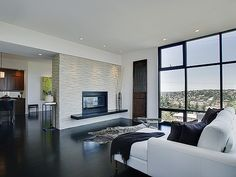 love the big windows and the middle fireplace