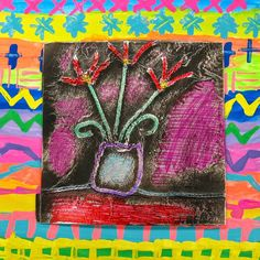 A while back, when mysecond grade was working on the Ojo de Dios, our lil table top trash cans were becomingfilled to the brim with yarn scraps. When I asked a student to empty the trash cans and th