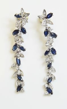 A pair of white gold sapphire and diamond cocktail drop earrings, For sale by auction, 20th May 2014, Estimate £400-500
