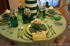 table setting...use 20 oz bottle with tops cut off to make legs to fill in the legs. add some St Patrick trinkets...hot glue felt to make them.